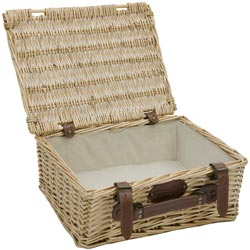 Empty wicker basket with cream fabric