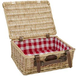 Empty wicker basket with red and white fabric